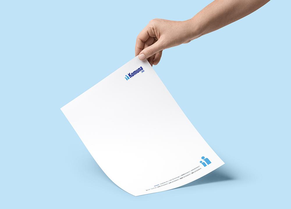 Briefpapier ontwerp Komuna Zorg
